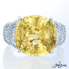 JB Star Platinum diamond ring featuring an exquisite 18.86 ct  cushion cut yellow sapphire embraced by six individually matched half moon diamonds.