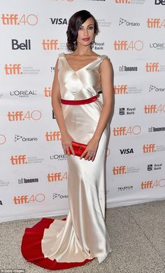 Satin: Actress and modelMădălina Diana Ghenea wore a white gown with dramatic red train...