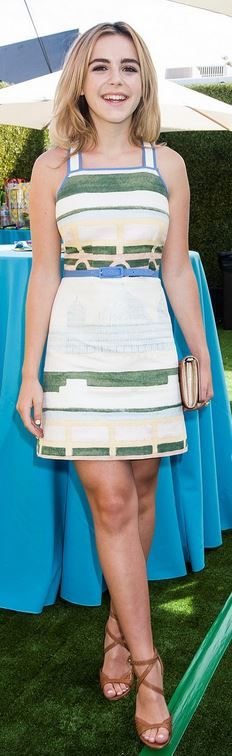 Who made Kiernan Shipka's white print dress, clutch handbag, and brown sandals that she wore in Hollywood on July 12, 2014