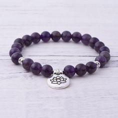 Our beautiful Amethyst Crown Chakra Bracelet 😍💚💜🌸This Amethyst bracelet facilitates meditation and brings a sense of spiritual calmness. It is said to be a 'stone of peace' that lifts the spirits and brings in hope. Chakra Bracelet, Amethyst Bracelet, Crown Chakra, Amethyst Stone, Beads And Wire, Bracelet Sizes, Bring It On, Beaded Bracelets, Gemstones