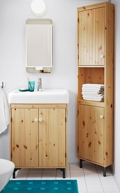 SILVERAN bathroom cabinets in light brown stained solid pine. You can move the shelf and adjust the spacing in the corner cabinet according to your personal needs.