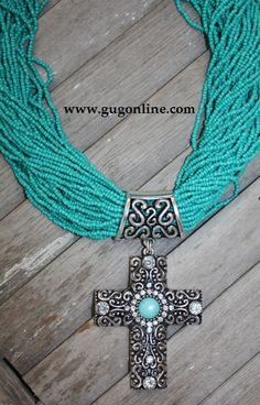 Multiple Strands of Turquoise with Crystal Cross Pendant