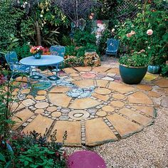 A patio of squares and rounds Colored stones, surrounded by pavers of stained concrete, create the illusion of a stream bubbling through the center of this 12-foot patio in Berkeley. Design: Keeyla Meadows, Keeyla Meadows Gardens & Art, Albany, CA