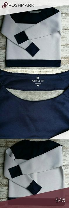 """Athleta sweatshirt  size xl *thicker material but not quite a traditional sweatshirt   *the navy portion is a bit lighter in weight   *marled gray white arms and body  *this would be a great cold weather layering shirt  *thumbholes in the sleeves  *26"""" shoulder to hem   It has a very faint spot but I'm getting ready to wash it Athleta Tops Sweatshirts & Hoodies"""