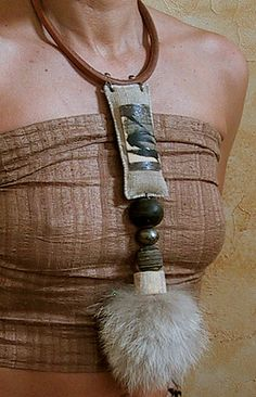 Amalthee - African beads handcrafted, wolf hair, bone and leather. Pendant central linen sewn decorated with a metal plate and calligraphy paper.