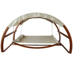 Leisure Season Medium Brown Porch Swing at Lowe's. Covered hammock, swing bed with canopy with adjustable height.When life is full of swing, you want to maximize your down time. This swing bed with canopy