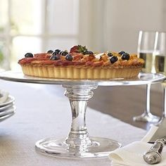 """Claro Cake Stand, Large - Put the spotlight on everyone's favorite course with these stately stands, which are hand blown in Poland of sparkling soda glass. 13"""" diameter, 6"""" high Hand blown and detailed with a scissor-cut rim. Ringed feature of the base is a signature detail of the Claro Collection. Made in Poland."""