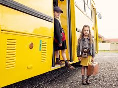 Katrina Tang Photography for MilK magazine Schoolbus SS 12 kids fashion. Two girl standing near a yellow schoolbus, suitcase, waiting, friends, photo camera #katrinatang #tangkatrina