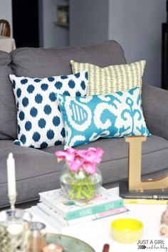 how to style a couch or sectional with toss cushions. Tips and ideas for living room decorating and decor