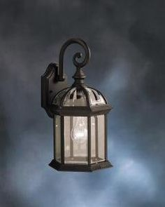 Kichler Lighting 9735BK Street Outdoor Sconce, Black by Kichler. $57.00. From the Manufacturer                Finish: Black, Glass: Clear Beveled, Light Bulb:(1)100w A19 Med F Incand With its timeless profile, the single-light New Street wall lantern is perfect for those looking to embellish classic sophistication outdoors. It will go well with any home décor while being able to withstand the elements.                                    Product Description             ...