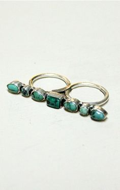 Turquoise 'double finger' ring - might have to try one of these