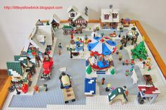 Little Yellow Brick - A Lego Blog: Our Lego Winter Village Town MOC - 10199 Winter Village Toy Shop, 10216 Winter Village Bakery, 10222 Winter Village Post Office, 10229 Winter Village Cottage and 10235 Winter Village Market!