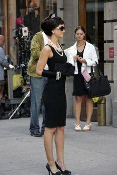 Calvin Klein dress. Prada shoes. Fendi sunglasses. Chanel necklaces.
