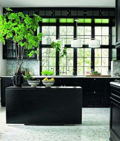 Dark cabinetry, hexagonal marble tile floor and a marble backsplash make this kitchen stand out.