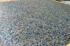 aggregate concrete    custom glass seeded exposed   What about seeding some red glass in front porch?