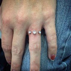 People Are Getting Diamond Dermal Piercings on Their Fingers in Place of Engagement Rings