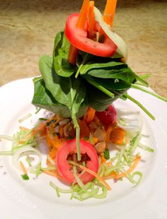 """Sweet potato with """"tofu sausage"""" and onions topped with spinach salad. (No oil.)"""