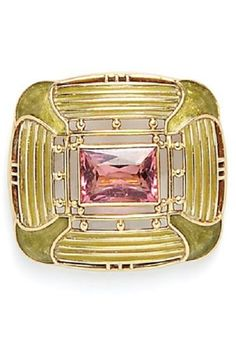 An Arts and Crafts 18kt Gold, Plique-à-Jour Enamel, and Pink Tourmaline Brooch, Tiffany & Co., c. 1916, bezel-set with a fancy-cut pink tourmaline, framed by beads, en plein enamel abstract lotus motifs, and panes of plique-à-jour enamel, signed. #LouisComfort #Tiffany #ArtsCrafts #brooch