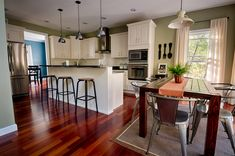 gorgeous open concept kitchen with industrial vibe