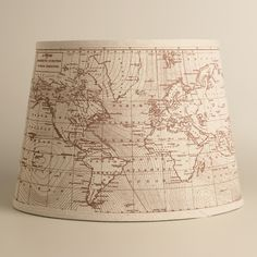 Our exclusive Vintage World Map Table Lamp Shade features an antique map of the world's magnetic field against a khaki cotton ground. Combine it with any of our table lamp bases to create a unique accent full of intricate detail. Table Lamp Shades, Table Lamp Base, Table Lamps, World Market Table, World Traveler Nursery, Lamp Shade Crafts, Lantern String Lights, Lanterns, Nautical Nursery