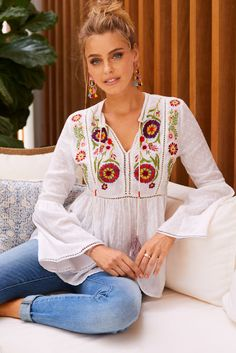 Vibrant floral embroidery accentuates this Swiss dot woven blouse. It's an effortless boho tunic top with a tassel-tie front, long flare sleeves and peekaboo lace details. Indian Fashion, Boho Fashion, Fashion Outfits, Mode Outfits, Casual Outfits, Estilo Hippie, Look Boho, Embroidered Clothes, Embroidered Tunic