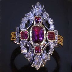 Early Victorian or Georgian ring with rose cut diamonds and rubies