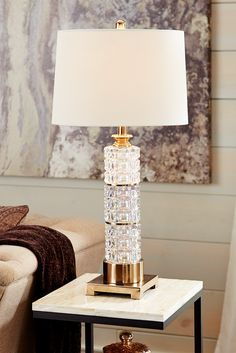 Honoring the alluring style of Art Deco, Pier 1's lustrous Prism Crystal Lamp mixes dark metal tones with dazzling prisms to create a style that's impossible to ignore. Light reflects off the shimmering prisms and instantly adds a romantic atmosphere to any space.