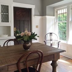 "oldfarmhouse: "" @freshfarmhouse pinterest""  Gray green walls old wooden kitchen table  Flowers in vase  Double Windows dining room late 19th century dining room inspiration"