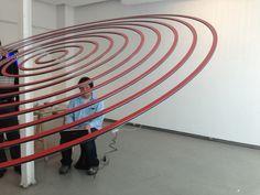 "Elias Crespin, Circuconcéntricos Blanco y Rojo, 2013. Installing the exhibition ""Art cinétique, art numérique"", Galerie Denise René Espace Marais, Paris Photo Atelier Crespin"