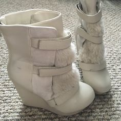 Juicy Couture Cream Fur Booties Super cute booties by Juicy Couture! Lightly worn. There are a few smudge marks which are shown in the picture, however, it is in the inside of the shoe... So not too noticeable. 4 1/2 wedge Juicy Couture Shoes Ankle Boots & Booties