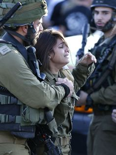 An Israeli female soldier reacts at the scene of a reported stabbing attack carried out by a Palestinian man against two Israeli soldiers, killing one of them, at a gas station on a main road near the West Bank village of Khirbit Al-Misbah between Jerusalem and Tel Aviv.  Emmanuel Dunand, AFP/Getty Images