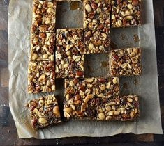 May your holiday baking begin! If you are a fan of pecan pie then you will simply adore these Maple Nut Bars. Most treats like this contain grains and sugars…