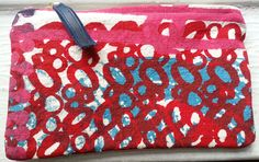 One of a kind bag. Great for organizing small items and cosmetics.  Hand screenprinted and handmade in USA