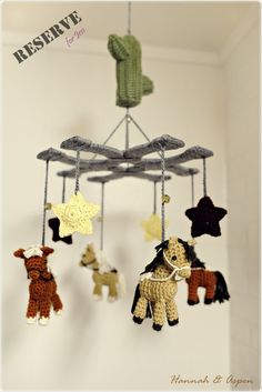 One day, I received a request from Jess. She's looking for something Western to match with her son's room. A crochet mobile contains horses, horseshoes and stars.
