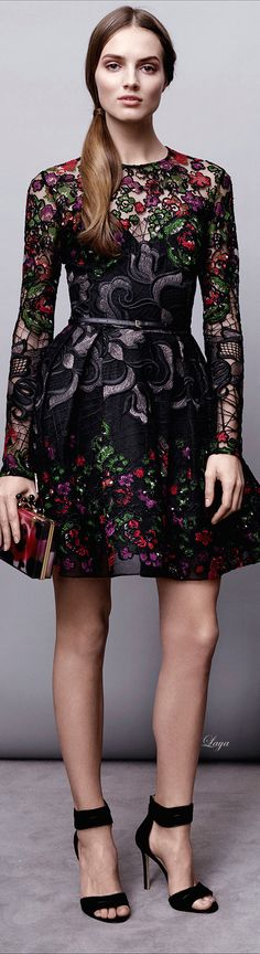 Elie Saab Pre-Fall 2015: This is a long sleeve black floral embroidered short dress. The embroidery looks exquisite!