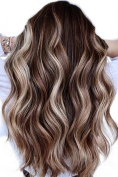 Look great in any season with this dimensional wavy blonde hair created by hair artist Caitlin (@coloredbycaitlin). Iron hair horizontally to achieve different wavy texture. Check out our website to see our list of long wavy hairstyles. #longwavyhair #wavyhairstyles Party Hairstyles For Long Hair, Haircuts For Wavy Hair, Curly Hair Cuts, Long Hair Cuts, Cool Hairstyles, Curly Hairstyle, Blonde Wavy Hair, Natural Wavy Hair, Blonde Dimensional Hair
