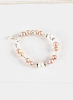 Beautiful! | Rose Pearl and Crystal Baby Bracelet from www.onesmallchild.com