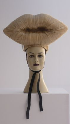 """Charlie Le Mindu, """"Blonde Lips"""", Sculptural Fashion, Natural human hair, plastic foundations, elastic head band, 2009. Additional Information: """"Blonde Lips is a unique piece crafted by extraordinary milliner, Charlie Le Mindu, for Lady Gaga to wear in the music video for 'Bad Romance', directed by Francis Lawrence."""""""