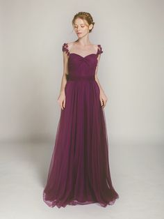 Aubergine tulle long bridesmaid dress with floral straps from Stylish Wedd