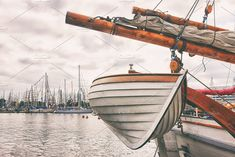 Boat on a sailing ship in port by VictorGrow on @creativemarket