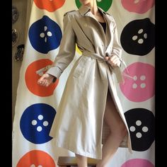 London Fog Perfect Beige Trench Coat Sleek Sexy Excellent condition. This comes from a smoke free home. No stains rips's holes or tears. Double-breasted. Military style plaid green blue yellow and white inside lining. Inside label says main coats. Weather wear of distinction. Londontown corporation. Baltimore.Shell fabric is 65% DAC Ron probably Esther and 35% combed cotton. Machine wash separately. 10 petite. Comes with two extra buttons. Classic. Classy. Basic. Professional. Business…