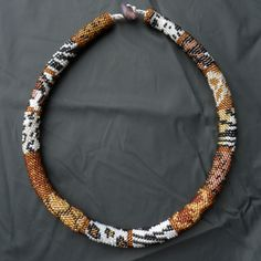 Cougar, a necklace with different kind of animal spots and stripes.  Miyuki beads size 11/0