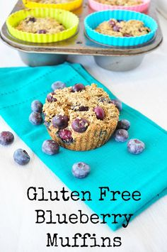 Super moist Gluten Free Blueberry Muffins that are bursting with blueberries and a hint of lemon.  These contain NO processed sugar and NO processed flour.  Easy recipe your kids will love!