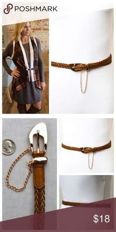 Genuine leather braided belt Genuine leather skinny braided belt with metal asymmetrical buckle and hanging chain detail. LT3010923 Accessories Belts
