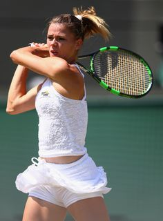 Camila Giorgi Photos Photos - Camila Giorgi of Italy returns a shot in her LadiesÂ' Singles Third Round match against Caroline Wozniacki of Denmark during day six of the Wimbledon Lawn Tennis Championships at the All England Lawn Tennis and Croquet Club on July 4, 2015 in London, England. - Day Six: The Championships - Wimbledon 2015