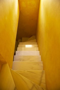 Marble stairs and golden yellow walls (saturated color) photographed by Brie Williams. via desire to inspire