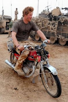 Prince Harry on a motorbike in his army gear. Swoon.