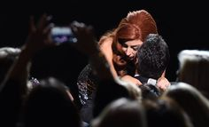 Pin for Later: Lady Gaga and Taylor Kinney Are All About the PDA Lady Gaga hugged Taylor during her New Year's Eve concert with Tony Bennett in Las Vegas in and he gave her a kiss on the cheek. Bo Derek, Taylor Kinney, Lancaster, Lady Gaga Artrave, New Years Eve Kiss, Couple Moments, Tony Bennett, Cute Woman, American Singers
