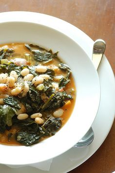 Savory Kale, Cannellini Bean, and Potato Soup - Full of fiber and protein, with flavors of rosemary, sage, and thyme, this kale, white bean, and potato soup is only 262 calories per delicious, steamy bowl.