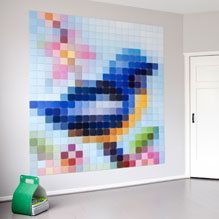 Pixelated art made up of small images that you print at home.  You could try doing this yourself using the exquisitely named Rasterbator:  http://homokaasu.org/diy-pope/